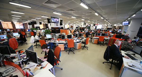 reporters-at-desks-in-newsroom