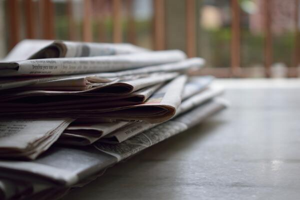 stack-of-newspapers-on-a-table