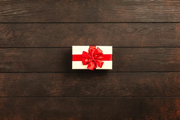 wrapped-gift-on-wooden-background