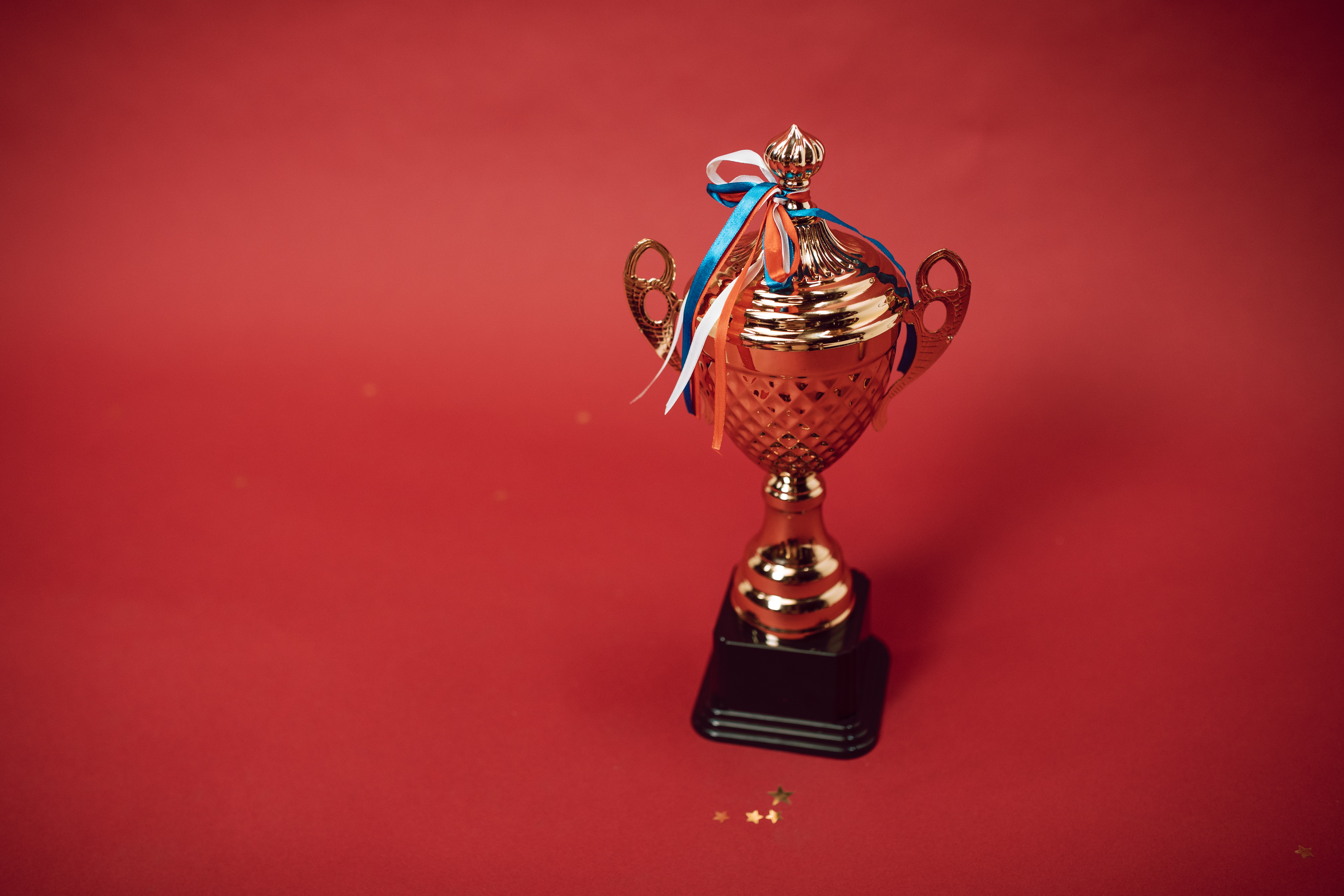 small-trophy-on-red-background